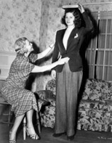 Drama coach Lela Rogers, mother of Ginger Rogers, gives poise and posture lessons to Lucille Ball, a promising young actress in New York's RKO Studios. Date unknown. (AP Photo)